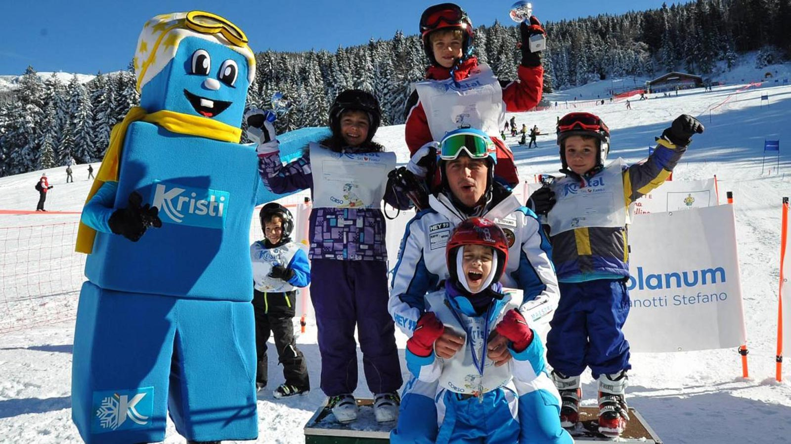 The ski school with Mascot Kristi near the Residence Antares in Andalo