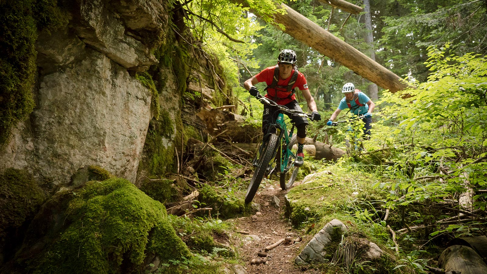 Two kids are hiking during a mountain bike holidays in Dolomites