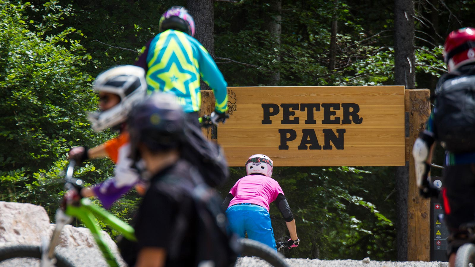 Detail of a sign that marks the path for children in a mountain bike holiday in Dolomites